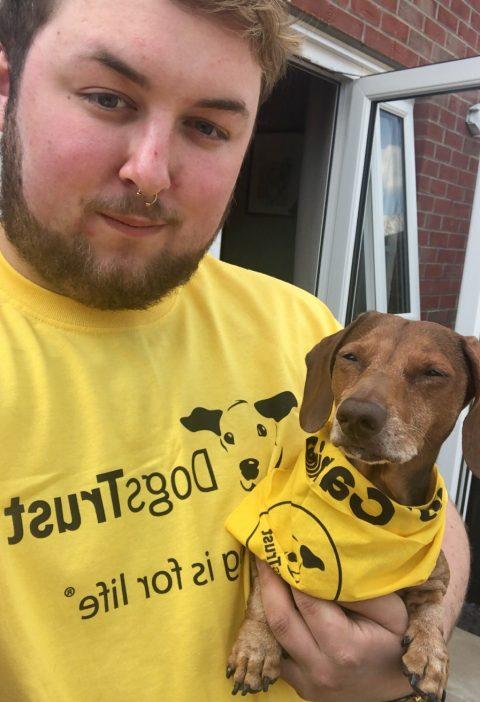 New Team Member Charlie, holding his dachshund Elvis.